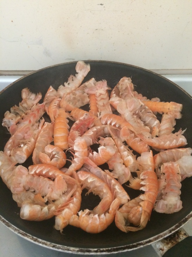 Scampi tails in the pan - the heads and claws went into a bisque which formed the basis of the sauce for the pasta.